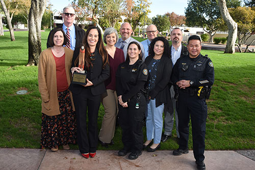 Employees receive Collaborate as a Team award for quickly solving the Jones Homicide case